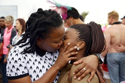 A couple kiss as members of the South African Lesbian, Gay, Bisexual and Transgender (LGBT) community take part in the annual Gay Pride Parade at Durban's North Beach as part of the three-day Durban Pride Festival in Durban on June 27, 2015. AFP PHOTO / RAJESH JANTILAL (Photo credit should read RAJESH JANTILAL/AFP/Getty Images)