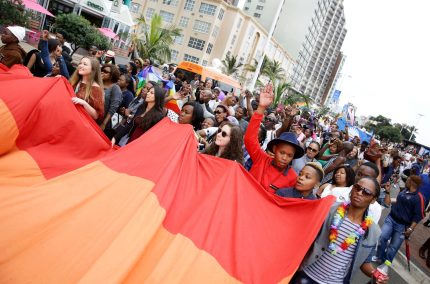 People hold a rainbow flag as they take part in the annual Gay Pride Parade at Durban's North Beach as part of the three-day Durban Pride Festival in Durban on June 27, 2015. AFP PHOTO / RAJESH JANTILAL        (Photo credit should read RAJESH JANTILAL/AFP/Getty Images)