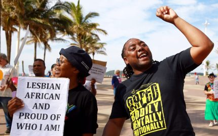 Gay rights activists participate in a demonstration rally marking the International Day Against Homophobia and Transphobia (IDAHOT) at the North Beach in Durban, on May 17, 2014. The 9th annual event, billed by organisers as the biggest LGBT solidarity event in the world, is aimed at raising awareness about discrimation facing the community and at calling for equal rights. AFP PHOTO / RAJESH JANTILAL        (Photo credit should read RAJESH JANTILAL/AFP/Getty Images)