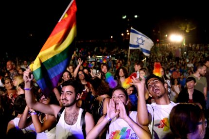 Israelis dance during the annual Jerusalem Gay Pride Parade on July 21, 2016. Israeli media said a record 25,000 people took part in Jerusalem's Gay Pride parade under heavy police protection, a year after an ultra-Orthodox Jew killed a teenager at the march. / AFP / GALI TIBBON        (Photo credit should read GALI TIBBON/AFP/Getty Images)