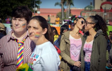 Couples march together as members of the South African Lesbian, Gay, Bisexual and Transgender and Intersex (LGBTI) community take part in the annual Gay Pride Parade, as part of the three-day Durban Pride Festival, on June 24, 2017 in Durban. / AFP PHOTO / RAJESH JANTILAL        (Photo credit should read RAJESH JANTILAL/AFP/Getty Images)