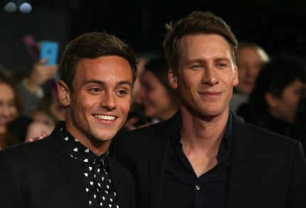 "Brtish Olympic athlete Tom Daley (L) and his partner American screenwriter Dustin Lance Black arrive to attend the UK Premiere of the film ""The Hunger Games: Mockingjay Part 2"" in central London on November 5, 2015. AFP PHOTO / JUSTIN TALLIS (Photo credit should read JUSTIN TALLIS/AFP/Getty Images)"