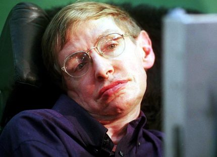 """BOMBAY, INDIA: World-renowned physicist Stephen Hawking answers questions with the help of a voice synthesiser during a press conference at the Tata Institute of Fundamental Research (TIFR) in Bombay, 06 January 2001. Hawking, along with over 300 physicists from across the world, will be attending a conference in String Theory called """"String 2001"""". (FILM) AFP PHOTO (Photo credit should read STR/AFP/Getty Images)"""