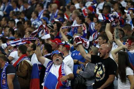 Slovakian fans cheer on their team during the World Cup 2018 qualification football match between England and Slovakia at Wembley Stadium in London on September 4, 2017. / AFP PHOTO / Adrian DENNIS / NOT FOR MARKETING OR ADVERTISING USE / RESTRICTED TO EDITORIAL USE (Photo credit should read ADRIAN DENNIS/AFP/Getty Images)
