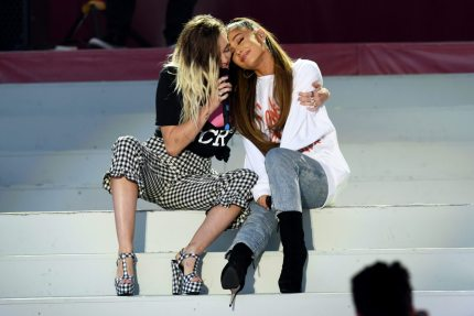 MANCHESTER, ENGLAND - JUNE 04: NO SALES, free for editorial use. In this handout provided by 'One Love Manchester' benefit concert (L) Miley Cyrus and Ariana Grande perform on stage on June 4, 2017 in Manchester, England. Donate at www.redcross.org.uk/love (Photo by Getty Images/Dave Hogan for One Love Manchester)