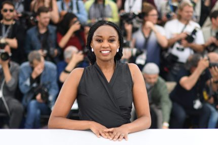 """Kenyan director Wanuri Kahiu poses on May 9, 2018 during a photocall for the film """"Rafiki"""" at the 71st edition of the Cannes Film Festival in Cannes, southern France. (Photo by LOIC VENANCE / AFP/ Getty)"""