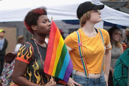 COLUMBUS, IN - APRIL 14: Residents and visitors attend the first Columbus Pride Festival on April 14, 2018 in Columbus, Indiana. Columbus is the hometown of Vice President Mike Pence, who has been a vocal opponent of LGBT issues. The festival, organized by high school senior Erin Bailey, drew hundreds of visitors to the small community located about 45 miles south of Indianapolis. (Photo by Scott Olson/Getty Images)