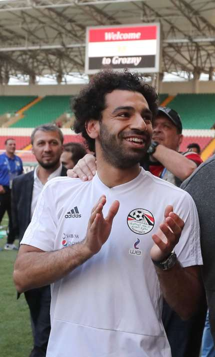 dcfdf2f48 Egyptian national team football player and Liverpool s star striker Mohamed  Salah (2ndR) and head