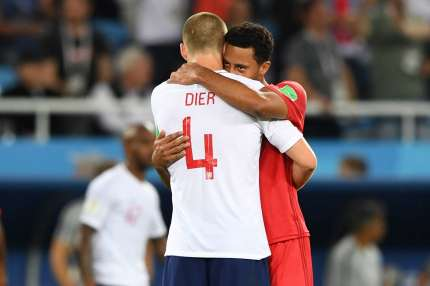TOPSHOT - England's midfielder Eric Dier (L) hugs Belgium's midfielder Moussa Dembele at the end of the Russia 2018 World Cup Group G football match between England and Belgium at the Kaliningrad Stadium in Kaliningrad on June 28, 2018. (Photo by OZAN KOSE / AFP) / RESTRICTED TO EDITORIAL USE - NO MOBILE PUSH ALERTS/DOWNLOADS        (Photo credit should read OZAN KOSE/AFP/Getty Images)