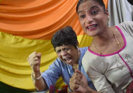 """Indian members and supporters of the lesbian, gay, bisexual, transgender (LGBT) community celebrate the Supreme Court decision to strike down a colonial-era ban on gay sex, in Mumbai on September 6, 2018. - India's Supreme Court on September 6 struck down the ban that has been at the centre of years of legal battles. """"The law had become a weapon for harassment for the LGBT community,"""" Chief Justice Dipak Misra said as he announced the landmark verdict. (Photo by INDRANIL MUKHERJEE / AFP) (Photo credit should read INDRANIL MUKHERJEE/AFP/Getty Images)"""