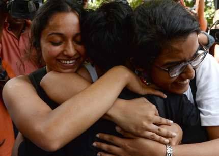 "Indian members of the lesbian, gay, bisexual, transgender (LGBT) community celebrate outside the Supreme Court after the decision to strike down the colonial-era ban on gay sex in New Delhi on September 6, 2018. - India's Supreme Court on September 6 struck down the ban that has been at the centre of years of legal battles. ""The law had become a weapon for harassment for the LGBT community,"" Chief Justice Dipak Misra said as he announced the landmark verdict. (Photo by Sajjad HUSSAIN / AFP) (Photo credit should read SAJJAD HUSSAIN/AFP/Getty Images)"