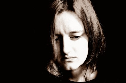 A sad woman, representing the higher rates of lesbian gay and bisexual people showing symptoms of depression