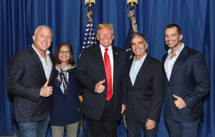 Donald Trump poses with Byan Eure and his husband Bill White