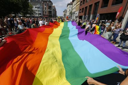 Pride flag held aloft at Belgium Pride. Cariad Jones has been hounded off Twitter by anti-trans trolls