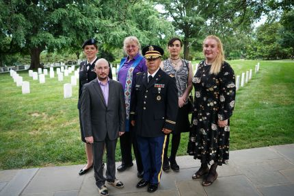 Trans troops pose for a photo in Arlington National Cemetery, from left: retired Army lieutenant colonel Ann Murdoch, Transgender American Veterans Association Vice President Gene Silvestri, Yvonne Cook-Riley, retired Army major and Transgender American Veterans Association President Evan Young, petty officer first class Alice Ashton and retired Air Force major Nella Ludlow