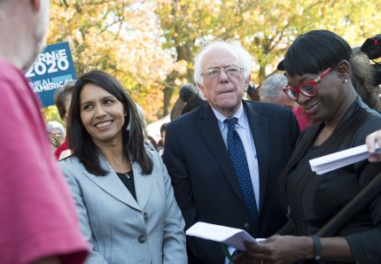 US Senator Bernie Sanders, (I-VT), waits alongside US Representative Tulsi Gabbard (L), Democrat of Hawaii.