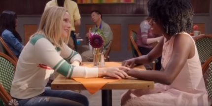 Eleanor Shellstrop (Kristen Bell) flirts with Simone (Kirby Howell-Baptiste) in an October 2018 episode of The Good Place