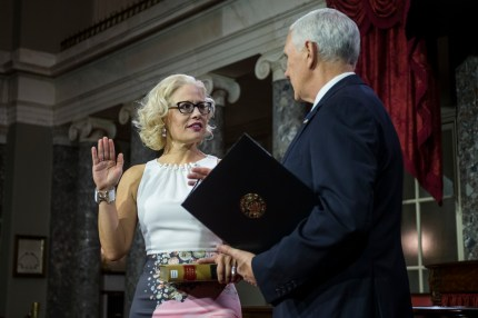 Senator Kyrsten Sinema participates in a swearing in ceremony with Vice President Mike Pence on Capitol Hill on January 3, 2019 in Washington, DC.