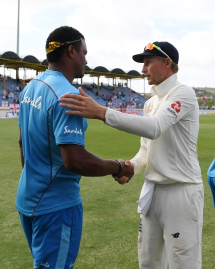 Shannon Gabriel of the West Indies with Joe Root of England following England's victory during Day Four of the Third Test match between the West Indies and England at Darren Sammy Cricket Ground on February 12, 2019 in Gros Islet, Saint Lucia