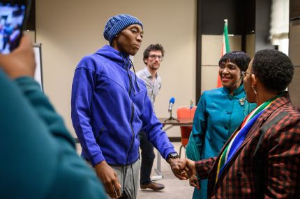 Olympic champion Caster Semenya (C), one of the female athletes that would be affected bu the IAAF rule condemned by the UNHRC resolution, eets South Africa's Sports Minister Tokozile Xasa (R) and South Africa's ambassador to the United Nations in Geneva, Nozipho Joyce Mxakato-Diseko.