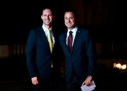 Luxembourg's Prime Minister Xavier Bettel (R) and his partner Gauthier Destenay arrives at the Musee d'Orsay in Paris on November 10, 2018 to attend a state dinner and a visit of the Picasso exhibition as part of ceremonies marking the 100th anniversary of the 11 November 1918 armistice, ending World War I.