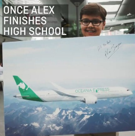 Oceania Express CEO Alex Jacquot looks at the camera while holding a rendering of his logo on a plane with the signature of Qantas CEO Alan Joyce.