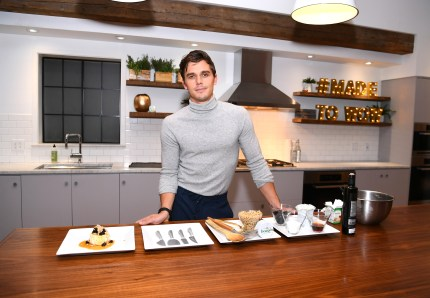 Antoni Porowski, who has become the subject of one of many Queer Eye memes, demonstrates preparing a signature dish as he attends Boursin Friendsgiving at Home Studios on November 7, 2018 in New York City.
