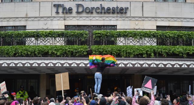 Protestors outside The Dorchester hotel in London. (Ella Braidwood)