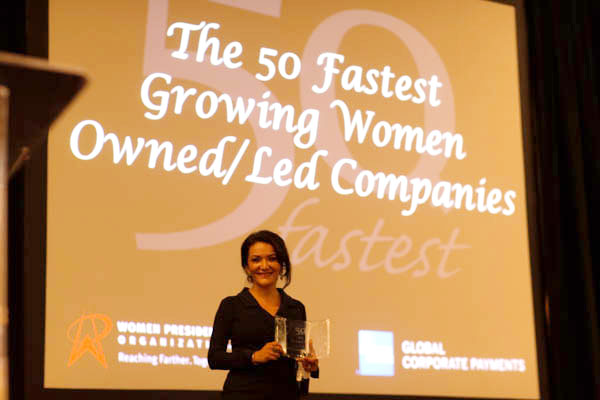 Nina Vaca accepts award for Pinnacle Group, which has been named the fastest growing women-owned/led firm in the U.S. by the Women Presidents' Organization.
