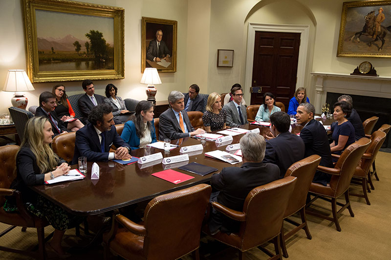 President Barack Obama drops by the first meeting of the Presidential Ambassadors for Global Entrepreneurship, with Commerce Secretary Penny Pritzker, in the Roosevelt Room of the White House, April 7, 2014. (Official White House Photo by Pete Souza)