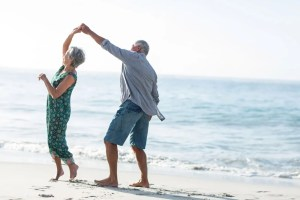 Senior Citizens dancing at the sands of a beach