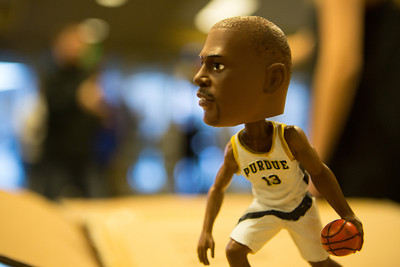 A Glenn Robinson bobblehead awaits pickup at a gate of Mackey Arena