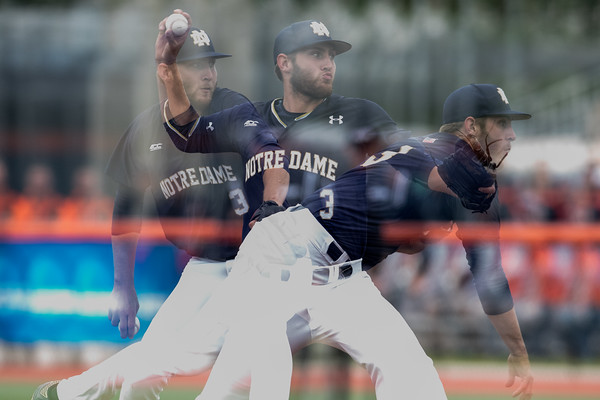 A multi exposure of Ryan Smoyer pitching during the NCAA Champaign Regional Game between Notre Dame and Illinois on May 31, 2015