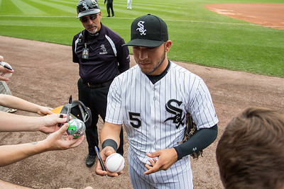 Carlos Sanchez of the Chicago White Sox signs autographs before a game