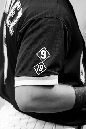 Patches honoring Minnie Minoso and Billy Pierce adorn the sleeve of Carlos Sanchez prior to the Chicago White Sox game against the Boston Red Sox on August 25, 2015