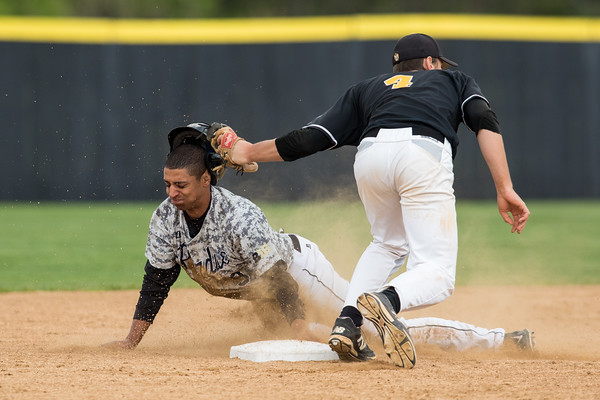 Brandon Krieg slides into second base as Spencer Mahoney applies the tag during the baseball game between the Valparaiso Crusaders and the Purdue Boilermakers on May 12, 2015