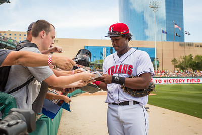 Josh Bell signs an autograph for a fan before the Indianapolis Indians game against the Charlotte Knights on August 1, 2015