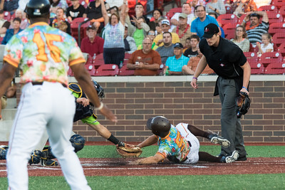 Chris Klenk slides into home plate for the Kokomo Jackrabbits of the Prospect League