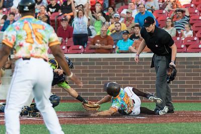 Chris Klenk slides into home plate for the Kokomo Jackrabbits of the Prospect League