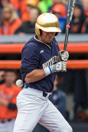 Ryan Bull is hit by a pitch during the NCAA Champaign Regional Game between Notre Dame and Illinois on May 31, 2015