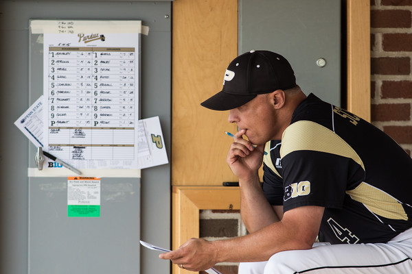 Purdue baseball coach Doug Schreiber spends a moment in the dugout during the Purdue baseball game against Penn State on May 14, 2015