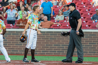 Chris Klenk argues with the umpire after being thrown out at home plate