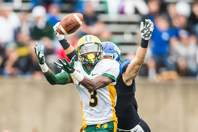 Tre Dempsey cuts in front of the reciever to try and make an interception for the North Dakota State Bison at Indiana State on October 24, 2015