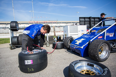 John Andretti fills a tire on his son Jarett Andretti's car prior to the Day Before the 500 race at Lucas Oil Raceway in Speedway, Indiana on May 23, 2015.