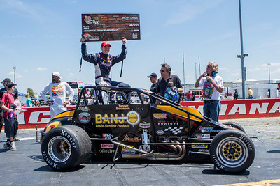 Tanner Swanson celebrates winning the Day Before the 500 race at Lucas Oil Raceway in Speedway, Indiana on May 23, 2015.