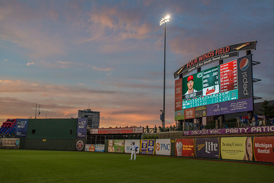 Jeffery Baez stands in right field of of Four Winds Field during the South Bend Cubs game against the Great Lakes Loons on 7-22-15