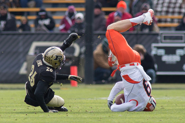Antoine Lewis upends Steve Hull of Illinois after Hull made a catch.