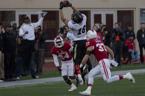 Cameron Posey (18) makes a catch as Coach Darrell Hazell leaps in the background during the Old Oaken Bucket game between the Purdue Boilermakers and the Indiana Hoosiers