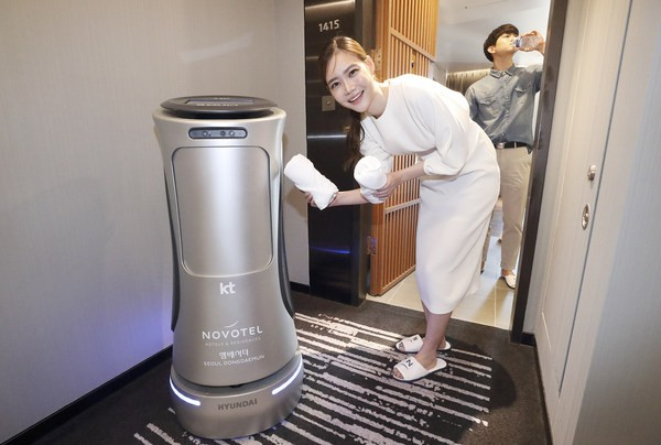 "KT's second-generation AI GiGA Genie hotel robot, dubbed ""N Bot,"" delivers water and towel to guest rooms, which is capable of larger and faster amenity deliveries than the previous version."