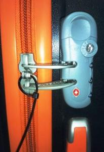 5 Tips to Protect Your Baggage from Airport Theft - TSA lock with cable tie